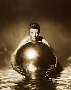 David Bowie grasping a globe... 1993 © Herb Ritts                                                                                                                                                     More