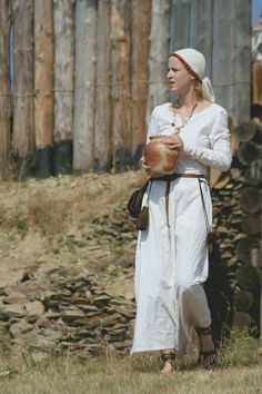 Costume of Slavic woman from the state of Great Moravia, c. 9th-11th centuries. Photo shot during the medieval festival in Curia Vítkov, Czech Republic .