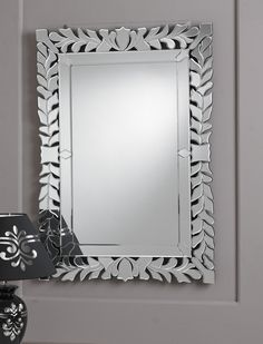 This is a superb example of a Venetian mirror, featuring a clear glass border made up of many small leaf like shapes, and covered in beautiful detailed etching. http://www.chicconcept.co.uk/venetian-mirrors/3256-venetian-mirror-100x70cm-5055157622243.html