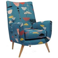Heal's midcentury-style Dinky armchair in Lucienne Day-inspired fabric. I wish that more people knew about the amazing Lucienne. Sigh....