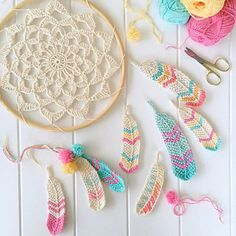 A quick and easy Tunisian crochet pattern for cute feather motifs.