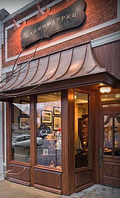 This dapper Lake Geneva storefront was designed and delivered by our very own, Woodland Furniture! Sculpting the details on interiors AND exteriors for every project. Next week. Facade Design, Exterior Design, Exterior Colors, Shop Facade, Restaurant Concept, Brick And Mortar, Lake Geneva, Shop Fronts, Shop Around