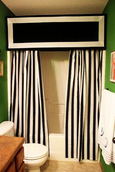 Finish off the look of your bathroom with a classic pelmut. A pelmut is a cornice board that is used to hide curtain fixtures.