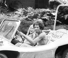 Jimi Hendrix driving a dune buggy with an unidentified woman. October 6, 1968.