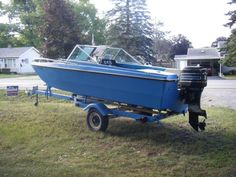 1972 BROWNING TRIHALL WITH MOTOR AND TRAILER