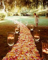 Whether your ceremony takes place outside amongst the trees, or takes cover from the cold inside, your aisle is the perfect platform for some fall style. Jazz it up with a seasonal aisle runner, and embellish with mini pumpkins, orange lanterns, and leaves in every color.