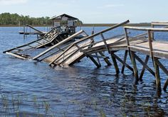 A dock damaged by the landfall of Hurricane Hermine is seen in the aftermath of the storm on Sept. 2, 2016, in Steinhatchee, Fla.