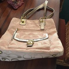 Coach pink and gold Coach pink and gold bag. No stains . Very nice bag lots of compartments. It is REAL. Coach Bags Shoulder Bags