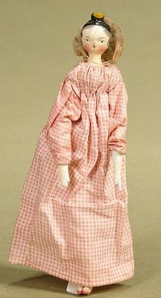 uck comb wooden Lady, Grodner Tal, Austria, circa 1820, gessoed and painted shoulder head, black painted hair, yellow comb, peg-jointed body and limbs, painted lower arms and legs, red shoes, wearing pink checked cotton dress and bonnet. 6 inches
