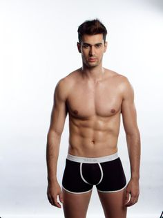 This high quality 100% cotton with a double-layer contour pouch and features special MIG logo waistband. This sporty low-rise trunk has tighter legs than a boxer brief creating a garment that has full coverage while allowing for comfort and ease of motion.  Materials: 95% Cotton 5% Lycra