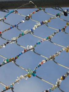 Bead bombing the chain link fences
