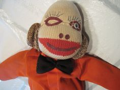 """Vintage homemade Sock Monkey with homemade polyester suit. Approx. 21"""" tall. Missing one eye."""