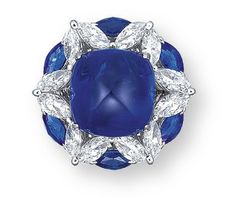 A SAPPHIRE AND DIAMOND RING  Set with a sugarloaf sapphire, within an undulating surround assembled by marquise-cut diamonds, spaced by marquise-cut sapphires, the reverse accented by brilliant-cut diamonds, mounted in platinum