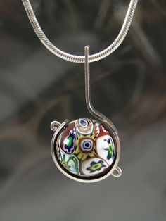 Necklace | Christine L Sundt. 'World Art' Millefiori bead, sterling silver