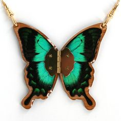 """""""Gilded Butterflies necklaces are one-of-a-kind art pieces. Inspired by the natural movement of butterflies, the necklaces are handmade in New Zealand using real butterfly wings."""" – Lisa Black, Artist, Gilded Butterflies"""