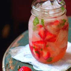 STRAWBERRY MOONSHINE MINT JELUP  2 large ripe strawberries, washed, hulled and cut into 1/4-inch pieces 2 tsp. sugar 3 leaves fresh mint 2 oz. moonshine or white whiskey, like Original Moonshine  1/2 oz. lemon juice Sprig of mint, for garnish  Combine cut strawberries, sugar, mint leaves in a cocktail shaker. Stir and let stand until strawberries are macerated, up to 10 minutes. Add moonshine, lemon juice, and ice to fill the shaker, and shake vigorously for an additional minute. Pour out…