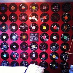 using old vinyl records to create art for my wall - paint splattered and hung with push pins!