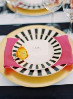 Colorful Kate Spade Inspired Wedding Ideas - Black and white, and gold plates with pink napkins
