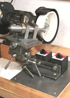 NICE! Well documented sharpening fixture that'll do dovetail cutters as well.