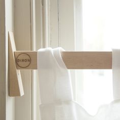 "CONSIDERED CURTAIN ROD $42.00  Maximum window width of 44""  Contains one curtain rod and one wedge.  Saw not included.  Made from oiled and laser cut Hard Maple.  44""L x 1.5""H x .75""D $42.00   The Considered Curtain Rod is a play on the DIY movement, requiring the user to cut the rod to length prior ..."