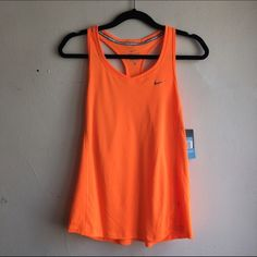 Bright Orange Nike Top Nike Running top NWT and in perfect condition. Bright orange. Dri-fit. KW001 Nike Tops Tank Tops
