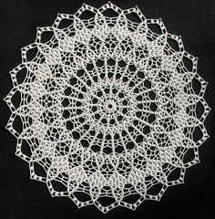 "Source: Coats & Clark, Book No. 197, Priscilla Doilies. Thread: Aunt Lydia 10. Color: #210 Antique White. Hook: Clover ST #4/1.25mm. Size: 19.5 inches dia. Made: Jan 25, 2009 (Group CAL).  Oddly enough, this doily didn't appeal to me until I blocked it.  It was slated for a ""give-away,"" but I quickly changed my mind and substituted another. :o))"