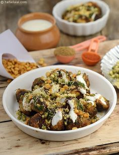 Aloo Chaat, tiny potatoes, marinated in Indian spices and sautéed in oil, are topped with moong, sev and other typical chaat add-ons.