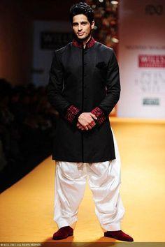 Smashing Sidharth Malhotra walk the ramp for designer Manish Malhotra on Day 3 of the Wills Lifestyle India Fashion Week (WIFW) 2013, held in Delhi.