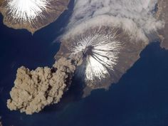 Cleveland Volcano releases a plume of ash that rises almost 20,000 feet (6,000 meters) above the North Pacific Ocean in this aerial photograph. Cleveland Volcano, located in the Aleutian Islands southwest of Alaska, failed to produce an eruption and the plume of ash detached from the volcano two hours after it formed.