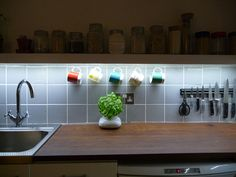 Under cabinet lighting always looks good! Check out our EasyFit light for a similar effect