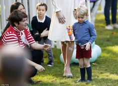 After seeming a little reserved to start with, Prince George was soon taken with an orange fish bubble gun, pictured