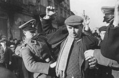 SS men search Jews for weapons. Warsaw, Poland, October or November 1939.