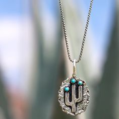 Swooning over this cactus pendant by Richard Schmidt Jewelry Design  Shop Sabi Boutique today and add this piece to your collection! #shopsabi #richardschmidtjewelrydesign #cactus #cactuslove #turquoise