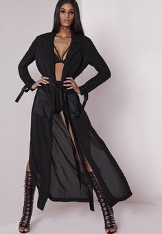 Get the Peace + Love look with this sublime sheer duster coat featuring a black on black satin tie waist, deep pockets and shoulder lapels. We love the luxurious  high end feel of this longline duster coat. Team over a super sexy bodycon dr...
