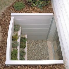 Creative basement window. Gives something beautiful to look at instead of steel well.