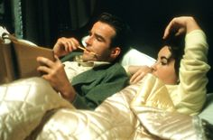 Montgomery Clift and Elizabeth Taylor in bed reading their scripts on the set of Raintree County (1957)