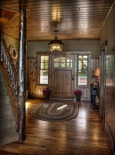 Rustic foyer & more Land's End Development