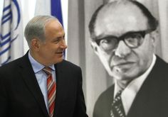 Prime Minister Benjamin Netanyahu walks in front of a poster of the late Prime Minister Menachem Begin upon his arrival at the Likud party meeting at the Menachem Begin Heritage Center in Jerusalem Photo By: REUTERS