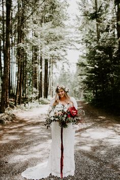 We love this classic long sleeve lace Saldana Vintage wedding dress and oversize two-toned red and white bridal bouquet and floral headpiece | image by Dawn Charles