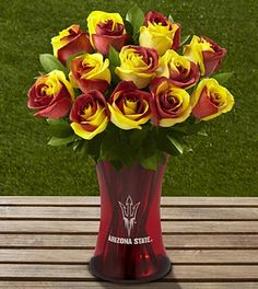 The FTD® Arizona State University® Sun Devils® Rose Bouquet - 12 Stems - VASE INCLUDED They offer bouquets for lots of different schools.  Great for graduation.