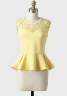 Yellow peplum with lace detail on the sweetheart neck line :)