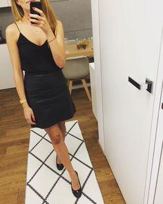 black (faux) leather skirt/black silk top pairing