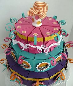 Paper Cake Treat Boxes. Put treats inside the boxes and people can take them as favors. This website has templates!