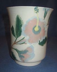 Originally designed around 1937 at Gladding McBean & Company in Glendale as part of their decorated Polynesia line of Catalina Pottery, the mold for this vase was purchased and reused at Weil around 1945. Weil utilized several such molds in their production.