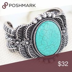 "Silvertone and Turquoise Floral Cuff Bold cuff will add western flair to any look!  Burnished Silvertone with Black Accents Multi-Textured Floral Design Faux Turquoise Stone Up to 2.25"" Wide Band 7.25"" Inside Circumference Including 1"" Gap No Closure Jewelry Bracelets"
