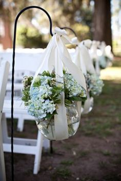 I very much like this! I had been thinking about using those hooky things to hang decor down the aisle. Its a yes!
