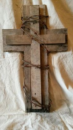 Cross I made from pallets and old barbed wire