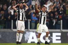Juventus' forward Paulo Dybala (R) from Argentina celebrates with teammate Gonzalo Higuain after scoring during the Italian Serie A football match Juventus Vs AC Milan on March 10, 2017 at the 'Juventus Stadium' in Turin.   / AFP PHOTO / Marco BERTORELLO