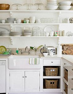 Take out the cupboards??!?!!? Hmmmmm....... It would be cheaper than replacing them, would make the kitchen seem larger, and it would encourage decluttering!