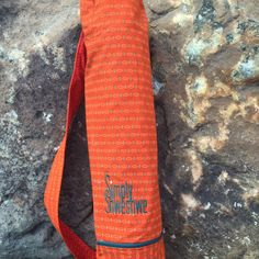 Orange Blaze Yoga Mat Bag handcrafted from the beautiful Shwwshwe fabric .